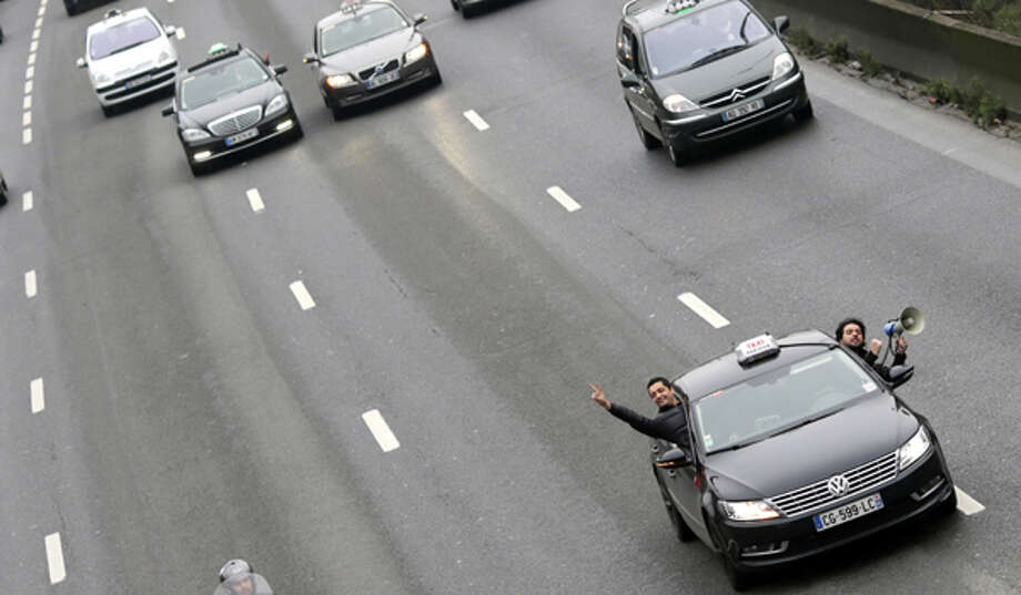 I've been behind a car where the driver and passenger switched seats while on the highway. Photo: KENZO TRIBOUILLARD, AFP/Getty Images / 2013 AFP