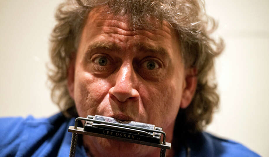 I saw a guy once on I-10 playing his harmonica while he was driving. He had one of those harmonica holders around his neck, and he was playing at the same time he was driving. Photo: The Washington Post, The Washington Post/Getty Images / 2013 The Washington Post