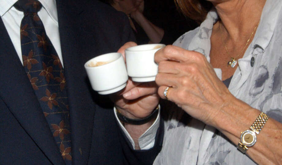 I once saw a  man who would lift his glass to every woman who pulled up next to him in traffic on I-45. I assumed it was alcohol. Who 'cheers' with coffee? Photo: Regis Martin, Getty Images / 2003 Regis Martin