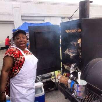 Black Sugar BBQ sells brisket-loaded baked potatoes at Battle of Flowers on Friday, April 25, 2014. Photo: Benjamin Olivo, San Antonio Express-News