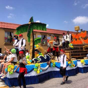 A pirate-themed float makes its way down Broadway during Battle of Flowers on Friday, April 25, 2014. Photo: Benjamin Olivo, San Antonio Express-News