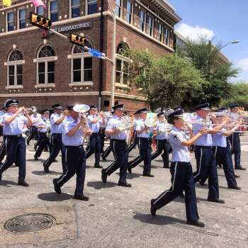 The U.S. Air Force Band of the West marches in Battle of Flowers on Friday, April 25, 2014. Photo: Benjamin Olivo, San Antonio Express-News