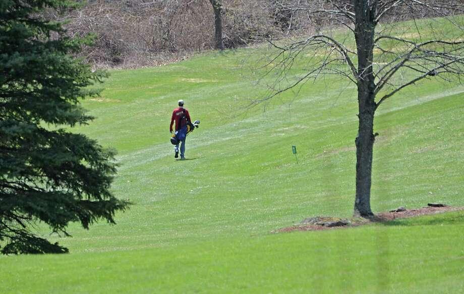 A golfer walks up a fairway at Brunswick Greens on Friday, April 25, 2014 in Brunswick, N.Y (Lori Van Buren / Times Union) Photo: Lori Van Buren