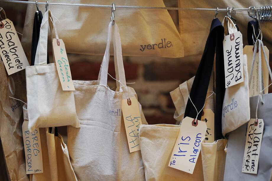 Items hang labeled and ready to be picked up at Yerdle's new S.F. headquarters. Photo: Leah Millis, San Francisco Chronicle