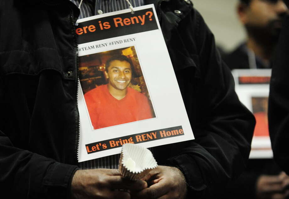A man wears a card with an image of Reny Jose on it during a candlelight vigil for Reny Jose, a Shaker High School graduate and currently a student of Rice University, on Sunday, March 9, 2014 in Loudonville. Jose went missing while on spring break with friends in Panama City, Florida. (Paul Buckowski / Times Union)