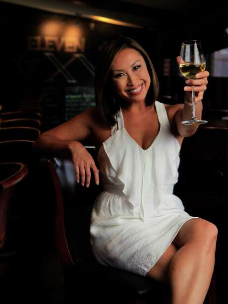 KHOU's news anchor Lily Jang hangs out at her favorite restaurant Eleven XI on West Gray, Monday, April 21, 2014, in Houston. ( Karen Warren / Houston Chronicle  ) Photo: Karen Warren, Staff / © 2014 Houston Chronicle