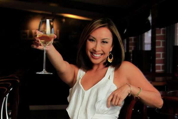 KHOU's news anchor Lily Jang hangs out at her favorite restaurant Eleven XI on West Gray with the liquid nitrogen smoke effect by Chef Kevin Bryant, Monday, April 21, 2014, in Houston. ( Karen Warren / Houston Chronicle  )