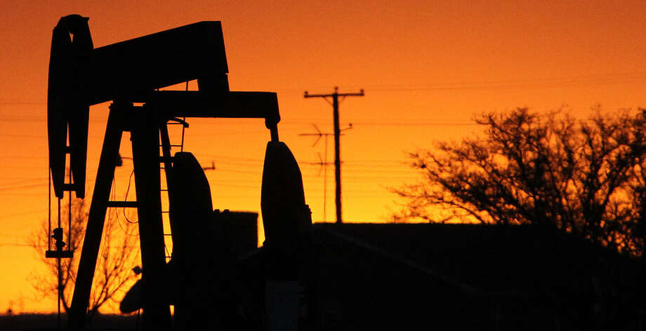 A pumpjack rocks back and forth as the sun sets in Stanton — a symbol of the productivity that may help Texas become the second-largest producer of oil in the world. With all that production, a reader wonders, why do gasoline prices remain so high? Photo: John Davenport / San Antonio Express-News / ©San Antonio Express-News