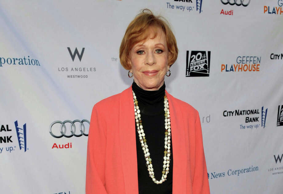 "FILE - In this June 4, 2012 publicity image provided by Geffen Playhouse, Carol Burnett arrives at the ""Backstage At The Geffen"" Fundraiser at the Geffen Playhouse, in Los Angeles. On Jan. 10, 2013, Burnett will be honored with the  ""Carol Burnett Honor of Distinction Award,"" presented by The Hollywood High School Performing Arts Center at the El Capitan Theatre in Hollywood, Calif. (AP Photo/Geffen Playhouse, John Shearer, File) Photo: John Shearer / Geffen Playhouse"