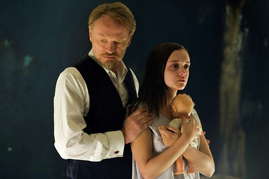 "This image released by Lionsgate shows Jared Harris, left, and Olivia Cooke in a scene from ""The Quiet Ones."" (AP Photo/Lionsgate, Chris Harris) ORG XMIT: NYET552 Photo: Chris Harris / Lionsgate"
