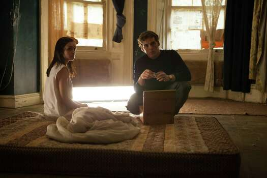 "This image released by Lionsgate shows Olivia Cooke, left, and Sam Claflin in a scene from ""The Quiet Ones."" (AP Photo/Lionsgate, Chris Harris) ORG XMIT: NYET551 Photo: Chris Harris / Lionsgate"