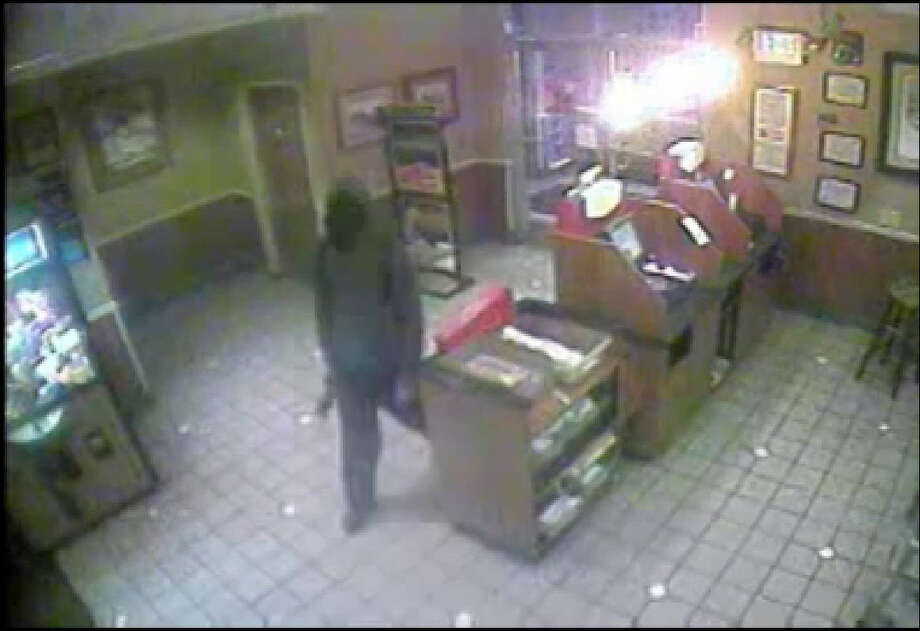 Two men armed with handguns robbed the Denny's at I-45 and Cypresswood late Tuesday night. Photo: Harris County Sheriff's Office