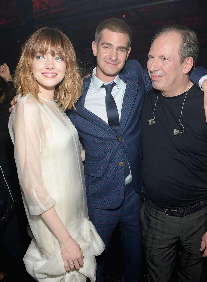 "Emma Stone, Andrew Garfield and Hans Zimmer attend the after party for ""The Amazing Spider-Man 2"" premiere at Skylight at Moynihan Station on April 24, 2014 in New York City. Photo: Jamie McCarthy, Getty Images"