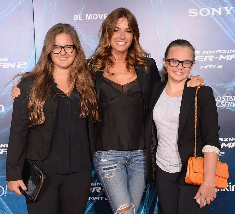 "Model Kelly Bensimon (C) and her daughters attend ""The Amazing Spider-Man 2"" premiere at the Ziegfeld Theater on April 24, 2014 in New York City. Photo: Jamie McCarthy, Getty Images"