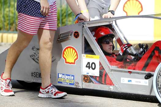 Tanner Stark, 17, of Ruston High School in Louisiana, gets ready to take off for a test drive in a prototype car at Shell's Eco-marathon Americas competition at the George R. Brown Convention center in downtown Houston in April 2014. College and high school student teams from across the Americas compete with their futuristic, super-mileage vehicles searching for solutions to make transportation more efficient while reducing environmental impact. Photo: Karen Warren, Houston Chronicle