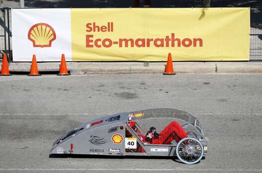 Tanner Stark, 17, of Ruston High School in Louisiana, takes a test drive in a prototype car at Shell's Eco-marathon Americas competition at the George R. Brown Convention center in downtown Houston in April 2014. College and high school student teams from across the Americas compete with their futuristic, super-mileage vehicles searching for solutions to make transportation more efficient while reducing environmental impact. Photo: Karen Warren, Houston Chronicle