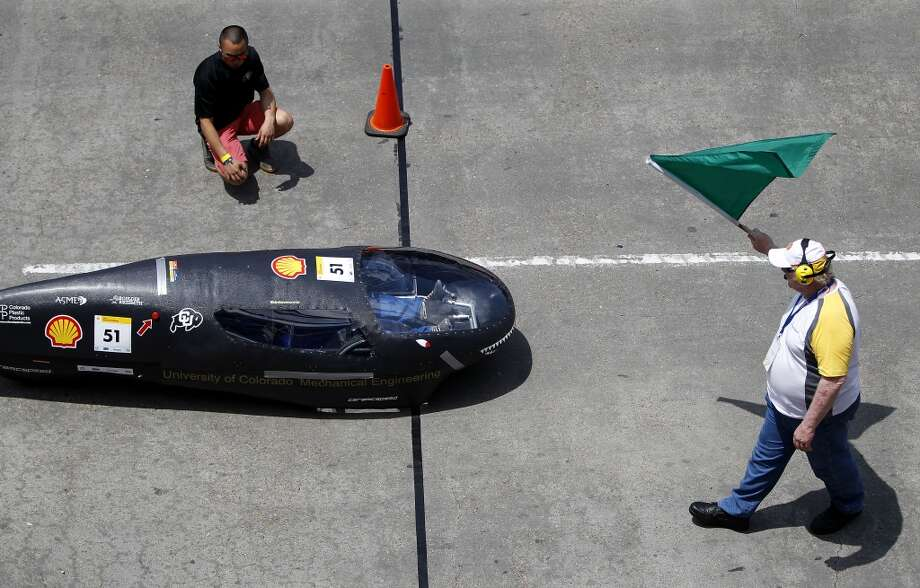The University of Colorado Boulder car is given the green light for take off for a test run at Shell's Eco-marathon Americas competition at the George R. Brown in downtown Houston in April 2014. College and high school student teams from across the Americas compete with their futuristic, super-mileage vehicles searching for solutions to make transportation more efficient while reducing environmental impact. Photo: Karen Warren, Houston Chronicle