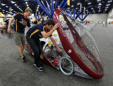 Members of Cedarville University's team push their prototype vehicle at Shell's Eco-marathon Americas competition at the George R. Brown Convention center in downtown Houston in April 2014. College and high school student teams from across the Americas compete with their futuristic, super-mileage vehicles searching for solutions to make transportation more efficient while reducing environmental impact. Photo: Karen Warren, Houston Chronicle