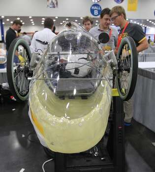Members of the St. John's School team, of Houston, work on placing the solar panel on their prototype car at Shell's Eco-marathon Americas competition at the George R. Brown Convention center in downtown Houston in April 2014. College and high school student teams from across the Americas compete with their futuristic, super-mileage vehicles searching for solutions to make transportation more efficient while reducing environmental impact. Photo: Karen Warren, Houston Chronicle