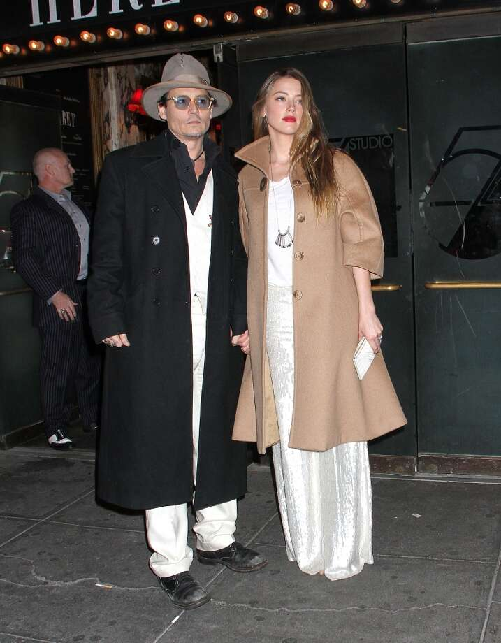 "Johnny Depp and Amber Heard attend the Broadway opening night of ""Cabaret"" at Studio 54 on April 24, 2014 in New York City. Photo: Laura Cavanaugh, Getty Images"