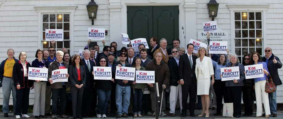 State Rep. Kim Fawcett, sixth from right, was joined Friday by U.S. Rep. Jim Himes, D-4, and First Selectman Michael Tetreau on the steps of Old Town Hall in officially declaring her candidacy for the 28th state Senate seat this year. Photo: Contributed Photo / Fairfield Citizen