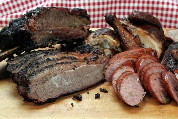 Barbecue brisket, sausage, chicken and beef rib from The Brisket House restaurant Thursday, April 17, 2014, in Houston. ( James Nielsen / Houston Chronicle )
