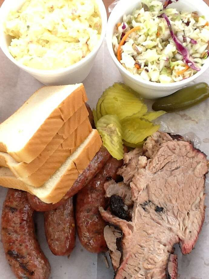Assorted meats and sides from Killen's Barbecue in Pearland. Photo: Greg Morago / Greg Morago