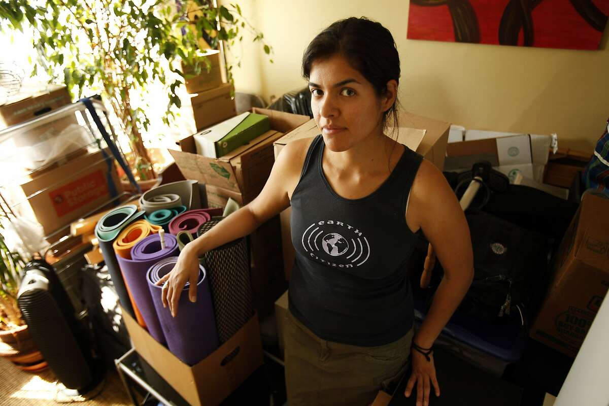 Claudia Flores moves things in what will soon be her third apartment in six months in San Francisco, Calif., on Sunday, April 20, 2014. Flores, who works for the city planning department, keeps getting forced out from high rent.