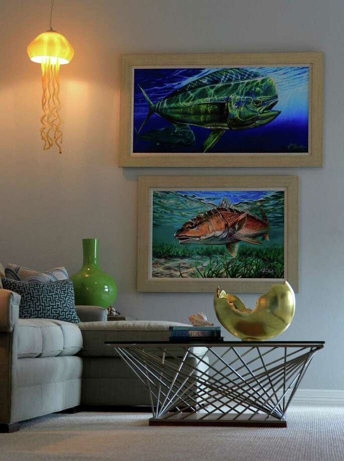 The entertainment room of the Tiki Island home owned by Kenneth Frieden,  includes contemporary furnishings and kitschy sea references, including a jellyfish lamp. ( Karen Warren / Houston Chronicle  ) Photo: Karen Warren, Staff / © 2014 Houston Chronicle