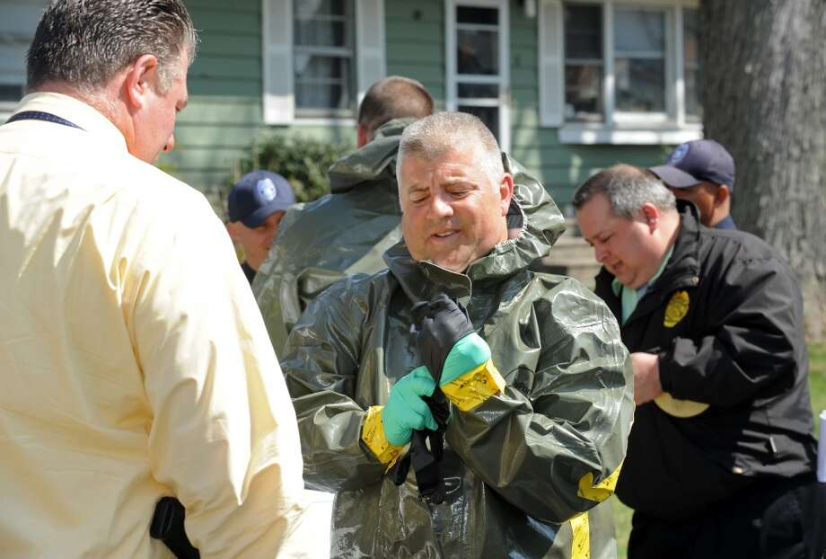 Detective Nihill suits up in a hazmat suit to enter the scene at 10 Eleanor Road in Seymour, Conn. on Friday, April, 25, 2014. Arthur Gauvin was arrested after his sister Nancy was found being held in the house. Photo: Cathy Zuraw