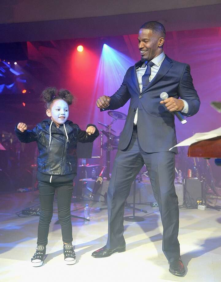 "Jamie Foxx (R) and his daughter Annalise dance on stage at the after party for ""The Amazing Spider-Man 2"" premiere at Skylight at Moynihan Station on April 24, 2014 in New York City. Photo: Jamie McCarthy, Getty Images"