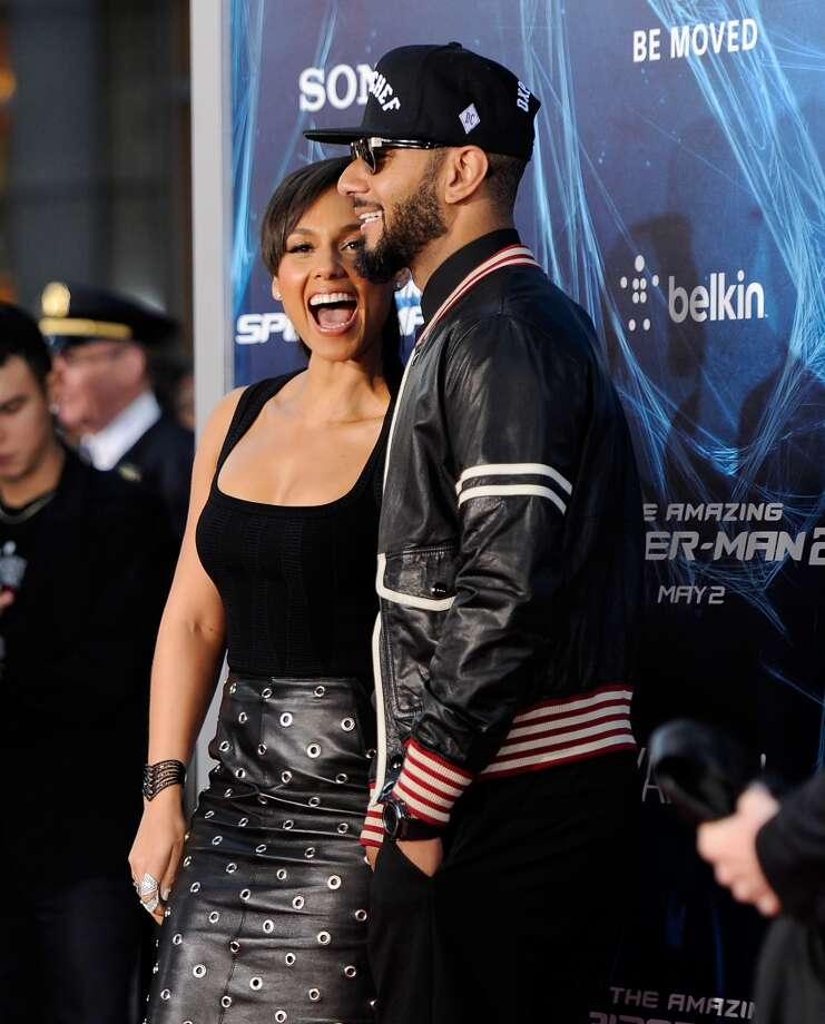 "Singer Alicia Keys and husband Swizz Beatz attend the premiere of  ""The Amazing Spider-Man 2"" at the Ziegfeld Theatre on Thursday, April 24, 2014, in New York. Photo: Evan Agostini, Associated Press"