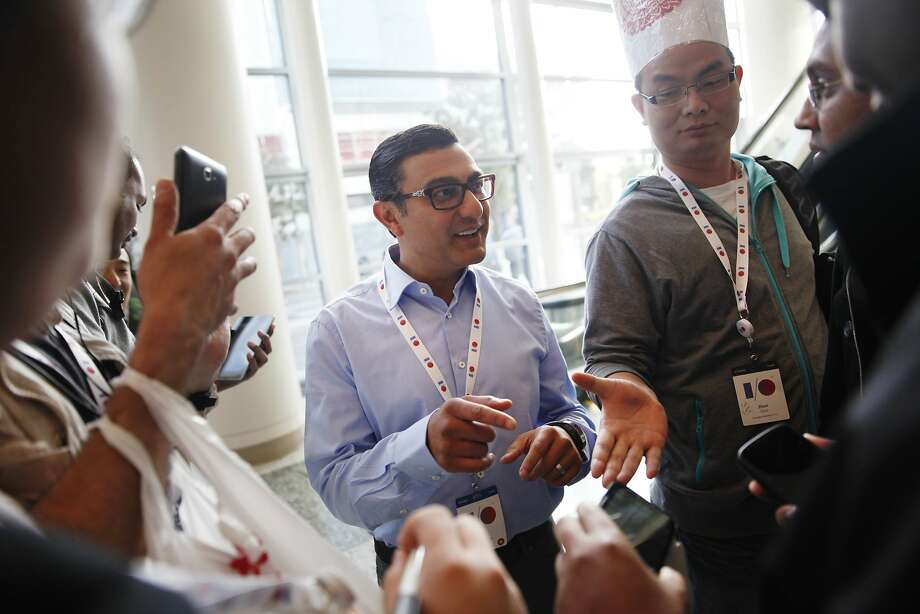 Vic Gundotra, senior vice president, engineering for Google, greets attendees lined up by the escalator on the ground floor of Moscone West before the start of the keynote presentation at Google I/O 2013 on Wednesday, May 15, 2013 in San Francisco, Calif. Photo: Lea Suzuki, The Chronicle