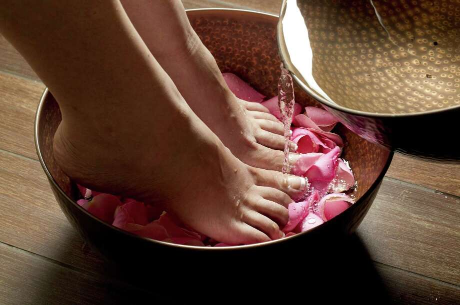 A foot bath with flower petals could be part of an all-day spa treatment at Daireds Salon/Spa Pangea in Arlington. Photo: Joyce Marshall / Fort Worth Star-Telegram