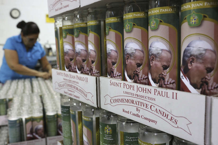 Candles commemora-ting Pope John Paul II's sainthood are readied for shipping as Rita Carrasco works to box them at Reed Candle Co. in San Antonio. Photo: Lisa Krantz / San Antonio Express-News / SAN ANTONIO EXPRESS-NEWS