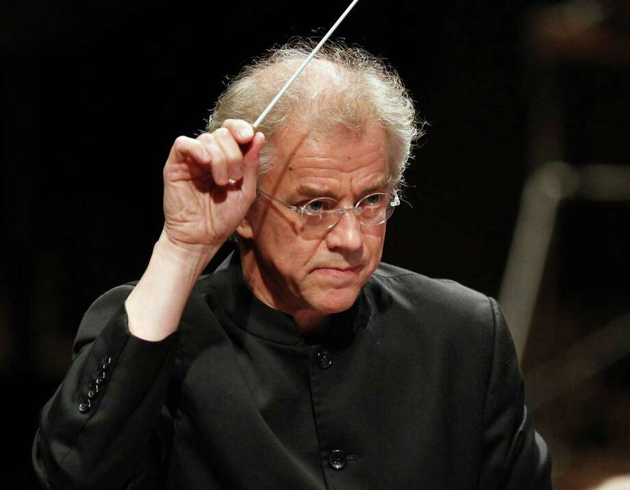 FILE - This undated file photo shows Minnesota Orchestra conductor Osmo Vanska during a performance in Minneapolis. Vanska is returning as music director of the Minnesota Orchestra. The orchestra's board said Thursday, April 24, 2014, that Vanska will lead at least 10 weeks of concerts for each of the next two seasons. Vanska resigned in October during a lockout of the orchestra's musicians that lasted more than a year. The dispute ended in January, when musicians agreed to pay cuts in a new three-year contract. (AP Photo/The Star Tribune, Tom Wallace, File)  MANDATORY CREDIT; ST. PAUL PIONEER PRESS OUT; MAGS OUT; TWIN CITIES TV OUT Photo: Tom Wallace, MBO / The Star Tribune