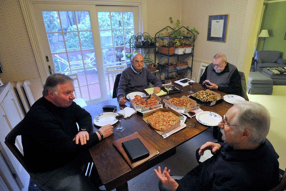 From left: Ken Koprowski, Bob Wirz, Doug Hearle and Julian Padowicz meet during their Writer's Bloc meeting at Julian Padowicz's house in Stamford, Conn., on Tuesday, April 15, 2014. Photo: Jason Rearick / Stamford Advocate