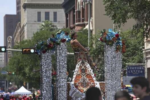 Lida Wilhelmina Emilia Steves, Duchess of the Kingdom of Wildlife, rides atop a float along Commerce Street during the Battle of Flowers Parade in San Antonio on Friday, April 25, 2014. Photo: Lisa Krantz, San Antonio Express-News