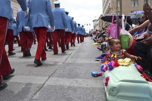 Nathalia Jaramillo, 1, sits in her own mini-float as the Texas Cavaliers pass during the Battle of Flowers Parade in San Antonio on Friday, April 25, 2014. Photo: Lisa Krantz, San Antonio Express-News