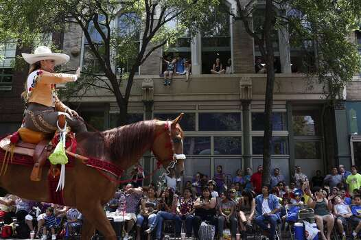 The Asociacion de Charros San Antonio passes the crowd on Commerce Street during the Battle of Flowers Parade in San Antonio on Friday, April 25, 2014. Photo: Lisa Krantz, San Antonio Express-News