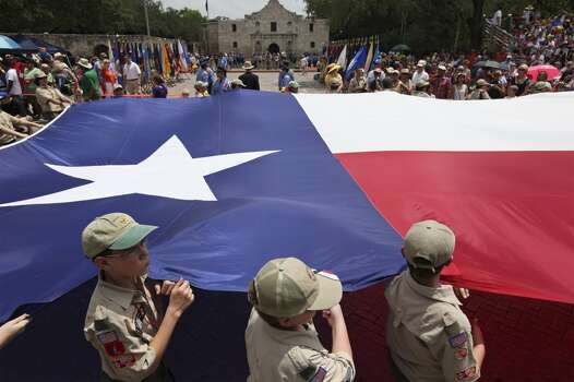 Members of the Boy Scouts of America, Alamo Area Council carrie the Texas flag past the Alamo Friday April 25, 2014 during the Battle of Flowers Parade. Photo: Edward A. Ornelas, San Antonio Express-News