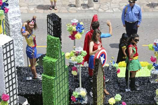 """The Robert G. Cole High School """"Make Believe in Superheroes"""" float passes through Alamo Plaza Friday April 25, 2014 during the Battle of Flowers Parade. Photo: Edward A. Ornelas, San Antonio Express-News"""