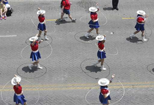 Members of the Thomas Jefferson High School Lariats Lassos Dance Team pass through Alamo Plaza Friday April 25, 2014 during the Battle of Flowers Parade. Photo: Edward A. Ornelas, San Antonio Express-News