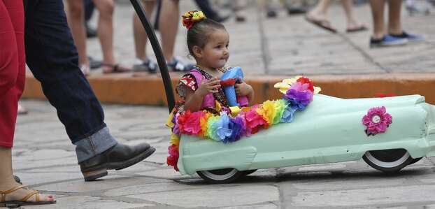 Nathalia Jaramillo takes in the sights in Alamo Plaza Friday April 25, 2014 before the Battle of Flowers Parade. Photo: Edward A. Ornelas, San Antonio Express-News
