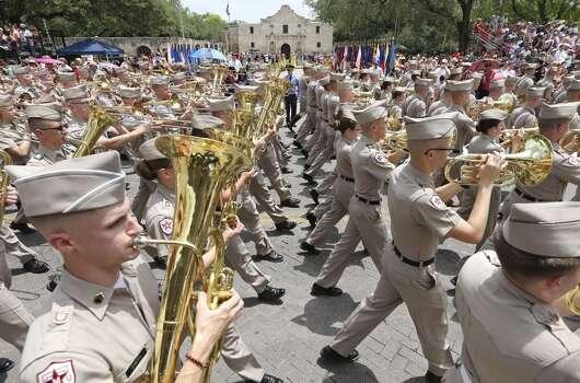 "The Texas A&M University ""Fightin' Texas Aggie Band"" passes the Alamo Friday April 25, 2014 during the Battle of Flowers Parade. Photo: Edward A. Ornelas, San Antonio Express-News"