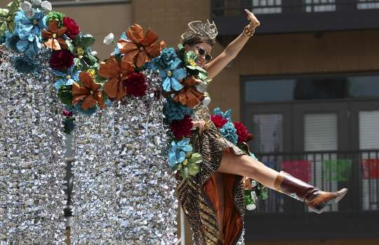 Duchess of the Kingdom of Wildlife Lida Wilhelmina Emilia Steves shows off her boots to the crowd at the 2014 Battle of Flowers parade on Friday, Apr. 25, 2014. (Kin Man Hui/San Antonio Express-News) Photo: Kin Man Hui, San Antonio Express-News