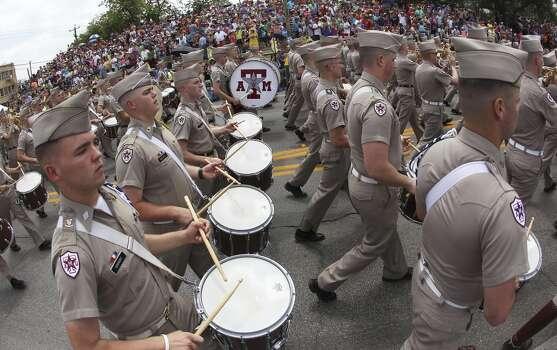The Fightin' Texas Aggie Band plays at the 2014 Battle of Flowers parade on Friday, Apr. 25, 2014. (Kin Man Hui/San Antonio Express-News) Photo: Kin Man Hui, San Antonio Express-News