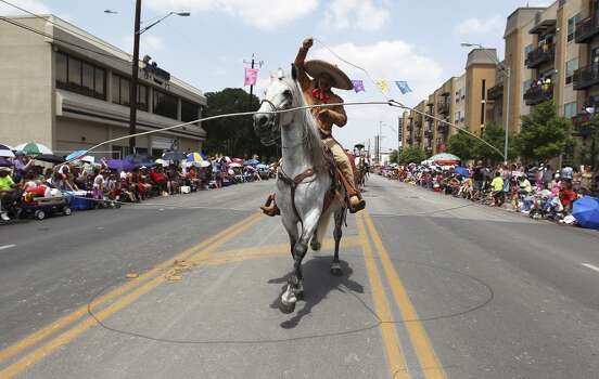A charro twirls his lasso around him and his horse as they take part in the 2014 Battle of Flowers parade on Friday, Apr. 25, 2014. (Kin Man Hui/San Antonio Express-News) Photo: Kin Man Hui, San Antonio Express-News