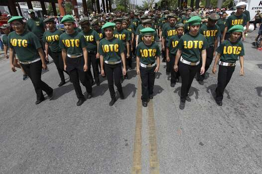 Students from the Longfellow Leadership Officer Training Corp line up to march in the 2014 Battle of Flowers parade on Friday, Apr. 25, 2014. (Kin Man Hui/San Antonio Express-News) Photo: Kin Man Hui, San Antonio Express-News