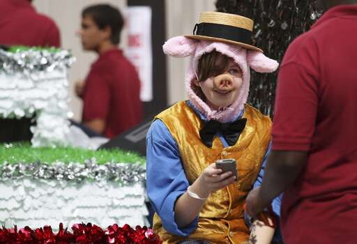 Adriel Carrillo from St. Anthony's awaits the start of the 2014 Battle of Flowers parade on Friday, Apr. 25, 2014. This year marked the first time St. Anthony's had a float in the parade. (Kin Man Hui/San Antonio Express-News) Photo: Kin Man Hui, San Antonio Express-News